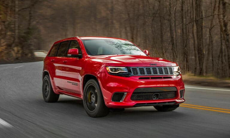 2021 Jeep Grand Cherokee driving through the forrest