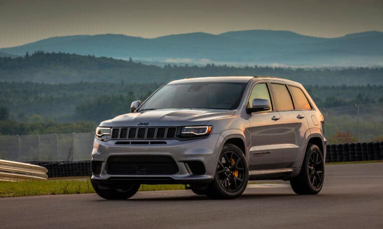 2021 Jeep Grand Cherokee driving on a track