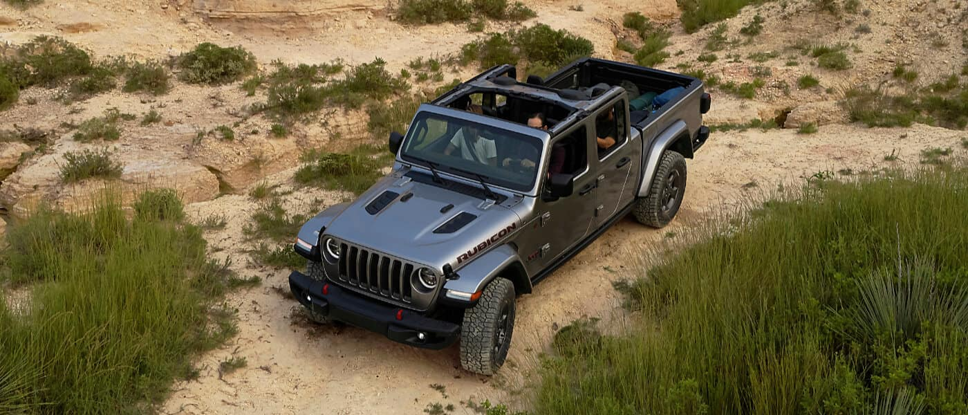 2021 Jeep Gladiator driving on rocky terrain exterior view