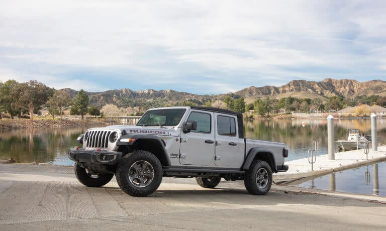 2021 Jeep Gladiator parked outside by a boat dock