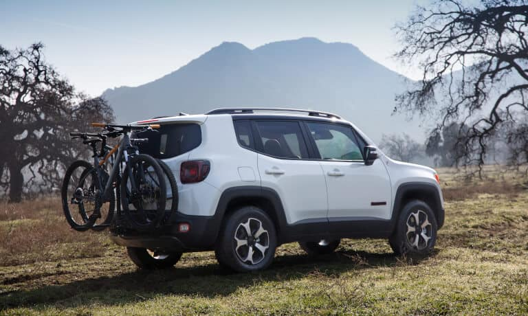 2021 Jeep Renagade outside with bikes attached to a trailer hitch