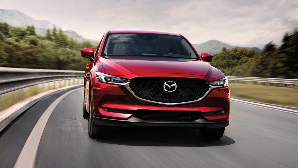 2017 Mazda CX-5 driving down a road