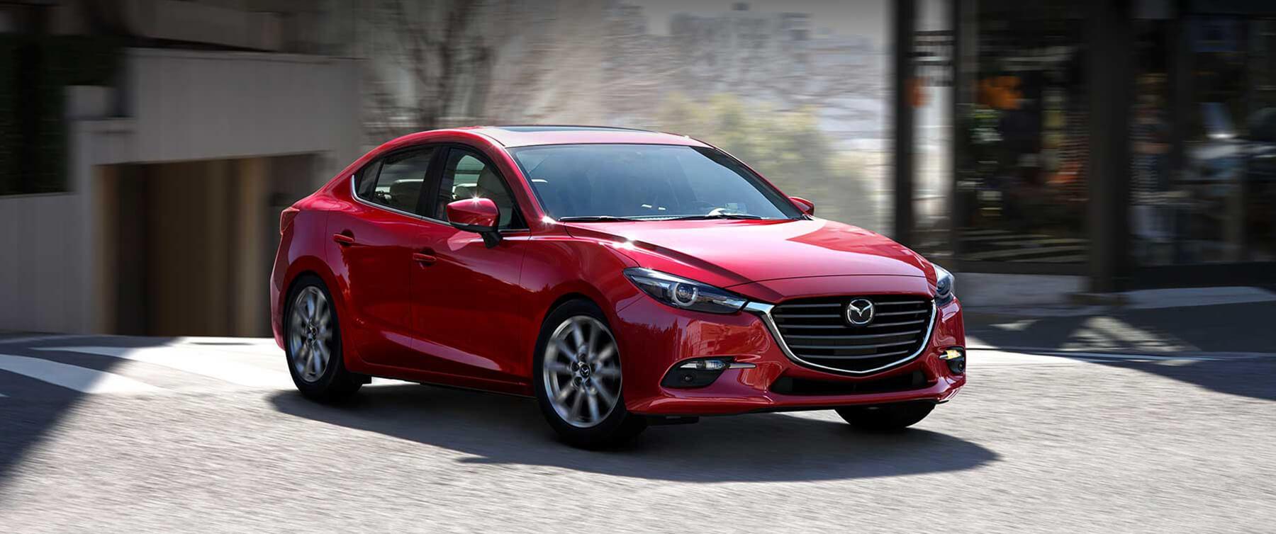 2017 Red Mazda3 4-door driving on street