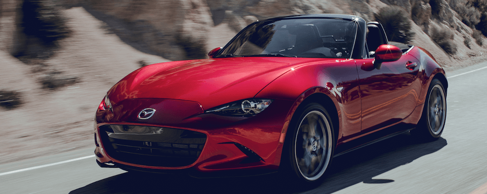 red 2019 Mazda Miata MX-5 roadster driving on mountain road