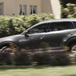 Mazda CX-9 SUV driving fast in suburbs