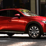 red 2019 Mazda cx-3 on urban street