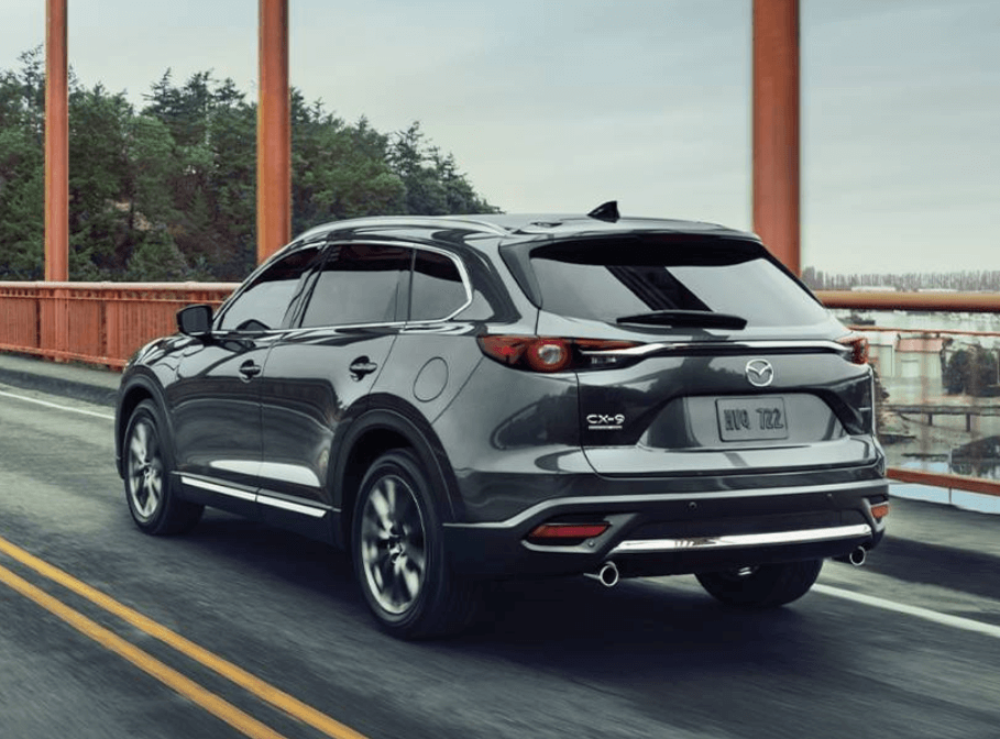 rearview image of 2020 Mazda CX-9 driving on highway