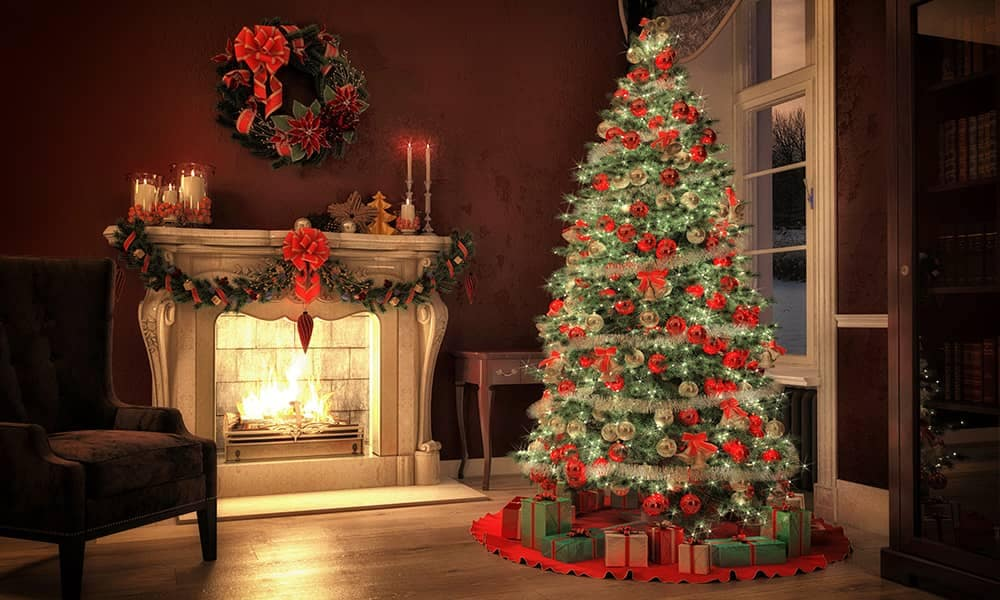 Christmas Tree Decorated Next to Fireplace
