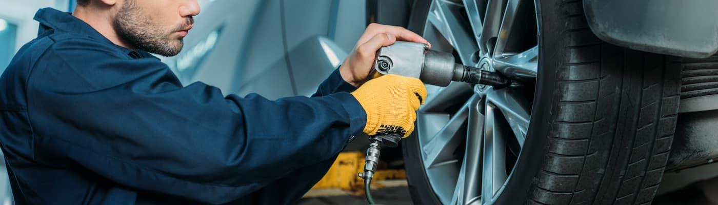 Man Rotating Tires