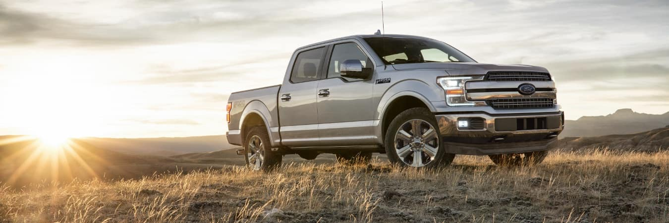 A 2018 Ford F-150 parked in front of the sunset