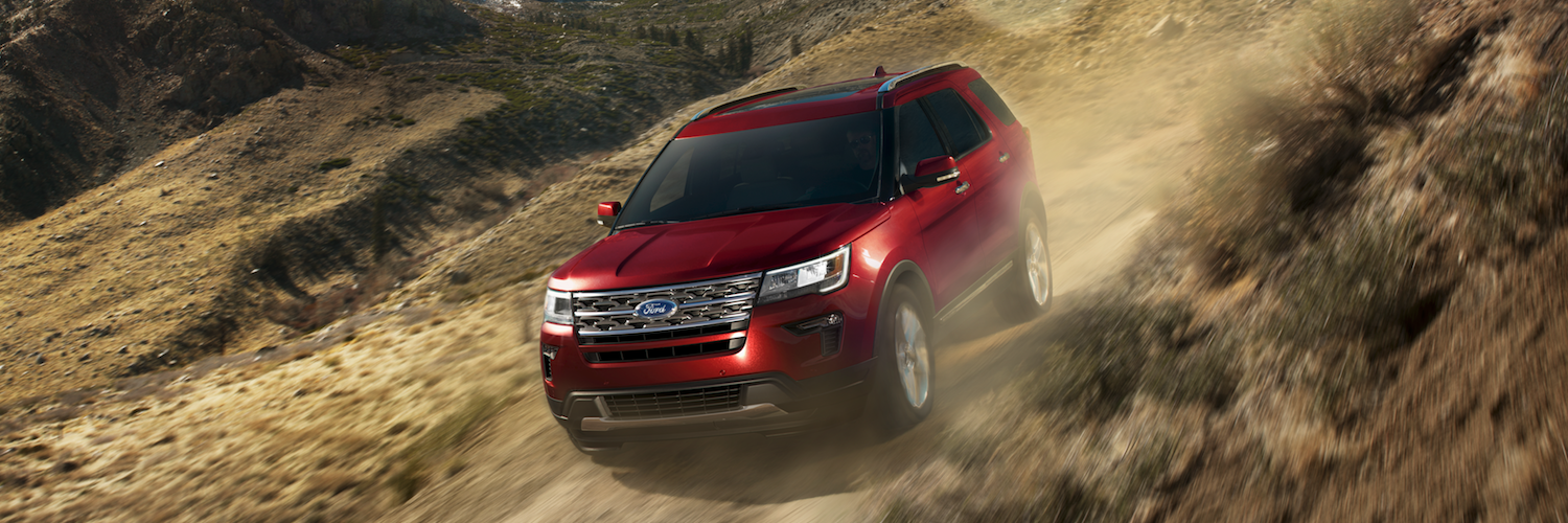 A red Ford Explorer offroading