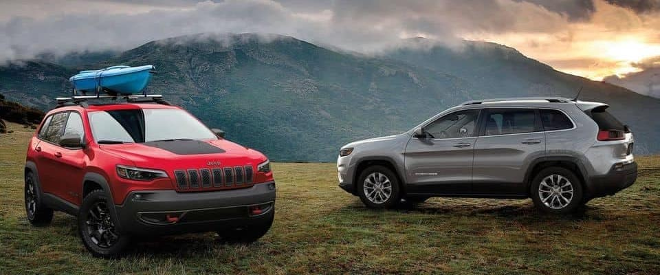 Red and Silver 2019 Jeep Cherokee SUVs parked on mountains