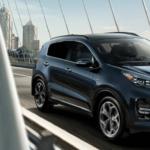 2022 Kia Sportage Driving on Bridge over City River