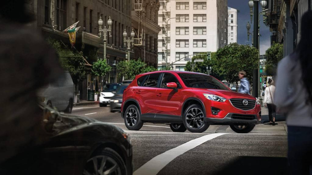2016-cx5-soulred-downtownintersection-mde