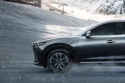 2018 Mazda CX-9 driving through winter snow