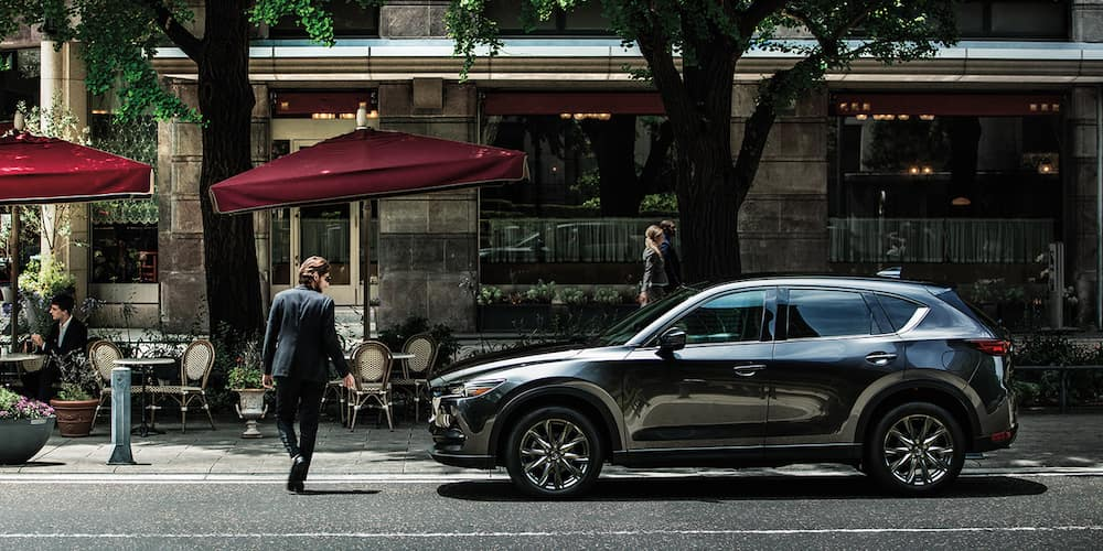 2020 CX-5 parked in front of a restaurant