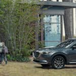 2020 Mazda CX-9 parked outside of a home in the woods