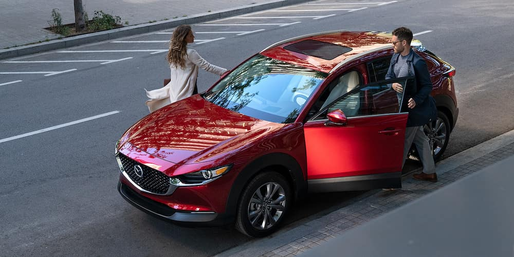 Couple getting into a parked 2020 Mazda CX-30