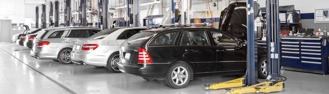 Cars parked in service bays at Mercedes-Benz dealership