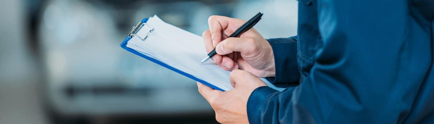 Mercedes-Benz client reviewing Service A checklist