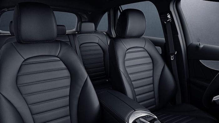 View of first and second row seats inside the GLC from front passenger's perspective