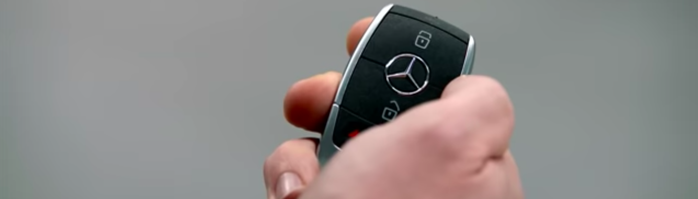 Hand holding Mercedes-Benz Smart Key Fob