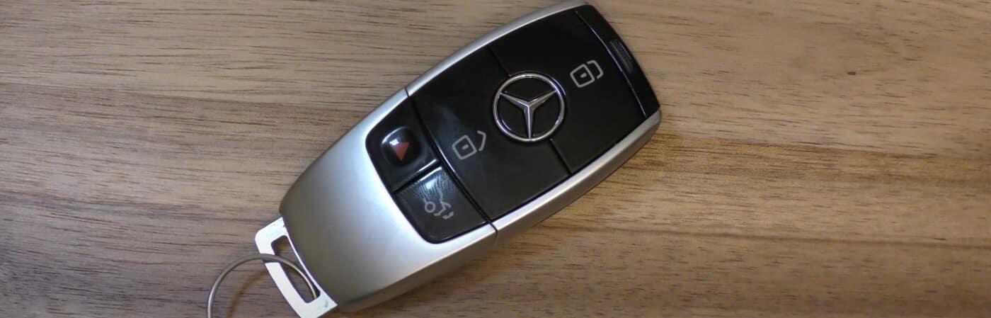 Mercedes-Benz key fob on a wood table