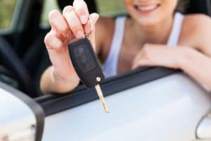 Girl with new car keys