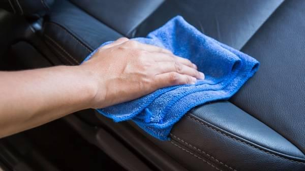 using a microfiber cloth on leather seats