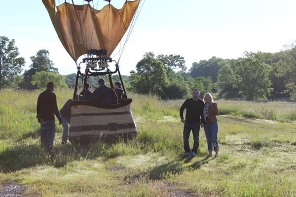 Couple Standing by Hot Air Balloon Before Take Off