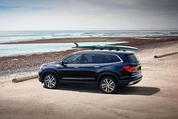 Blue CRV on beach