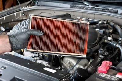Mechanic showing dirty air filter