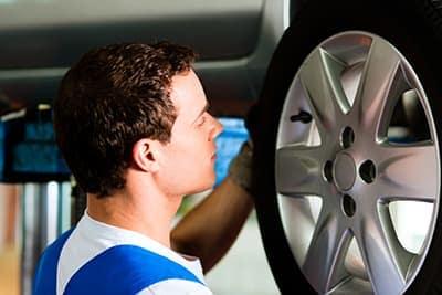 mechanic doing a tire rotation