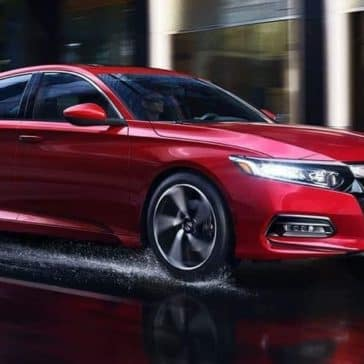 2019 Honda Accord driving across wet street