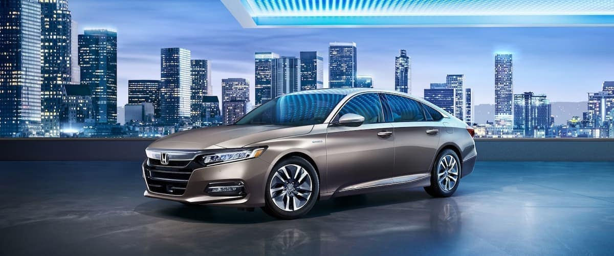 2019 Honda Accord with city skyline in background