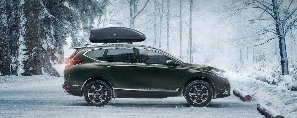 2019-cr-v parked in snowy woods with roof box