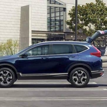 Couple loading cargo into 2019 Honda CR-V