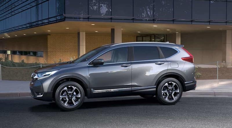 Gray CR-V parked in front of a building