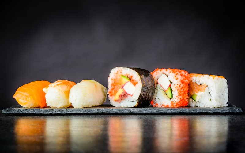 line of sushi rolls