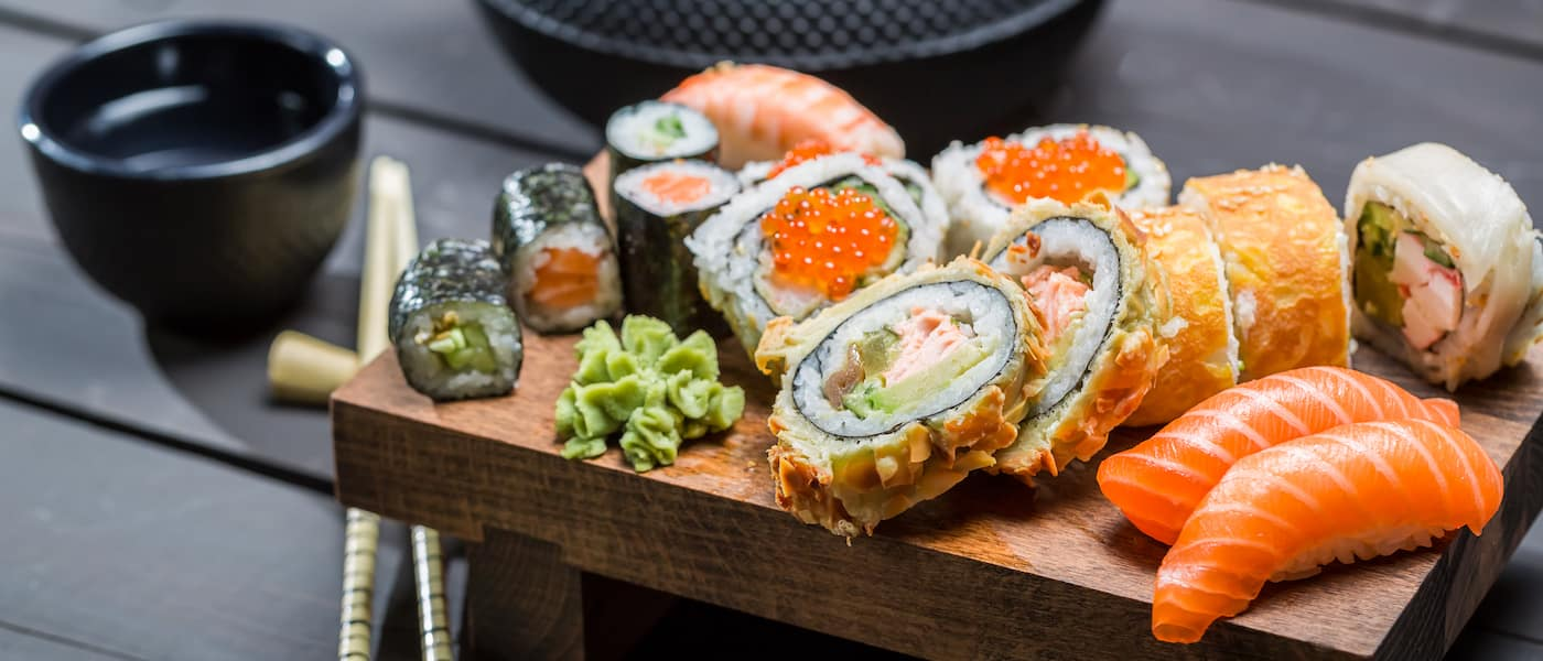 Sushi rolls on a wooden platter