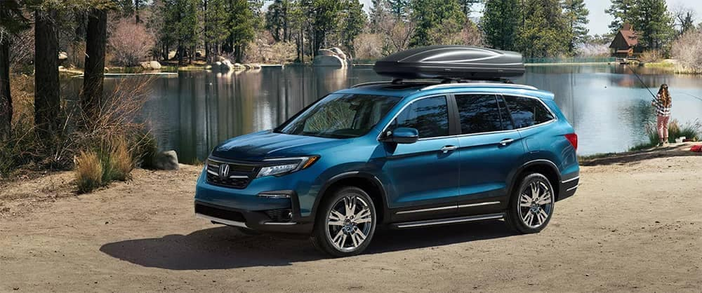 2019 Honda Pilot Blue Parked at Lake