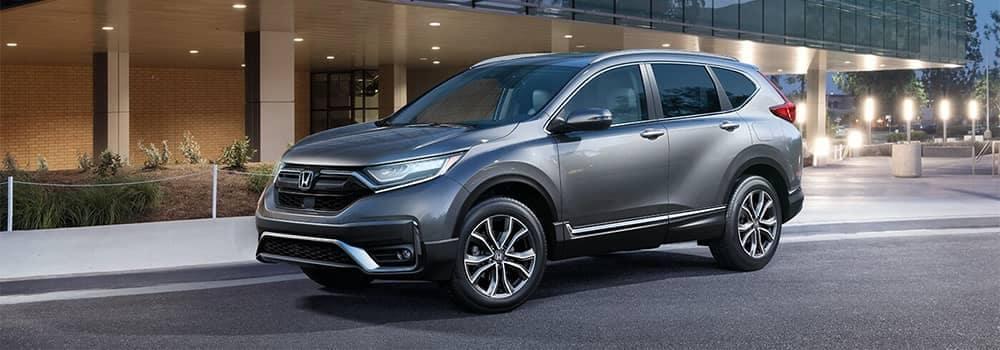 Honda CR-V Parked Outside Building