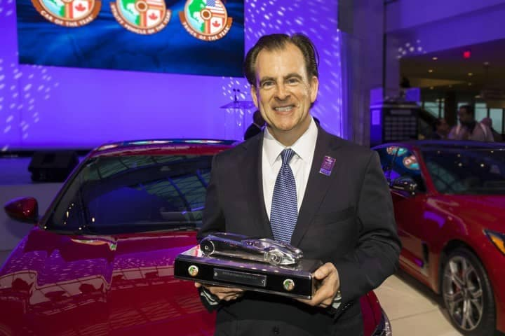 Henio Arcangeli, Senior Vice President of the Automobile Division of American Honda Motor Co., accepts the award for 2018 North American Car of the Year