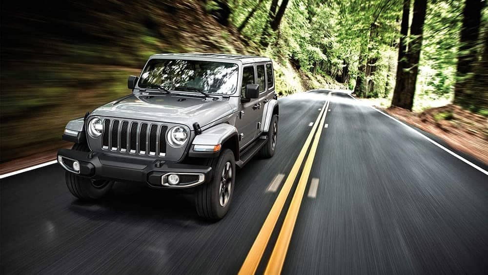 2019 Jeep Wrangler driving on forest
