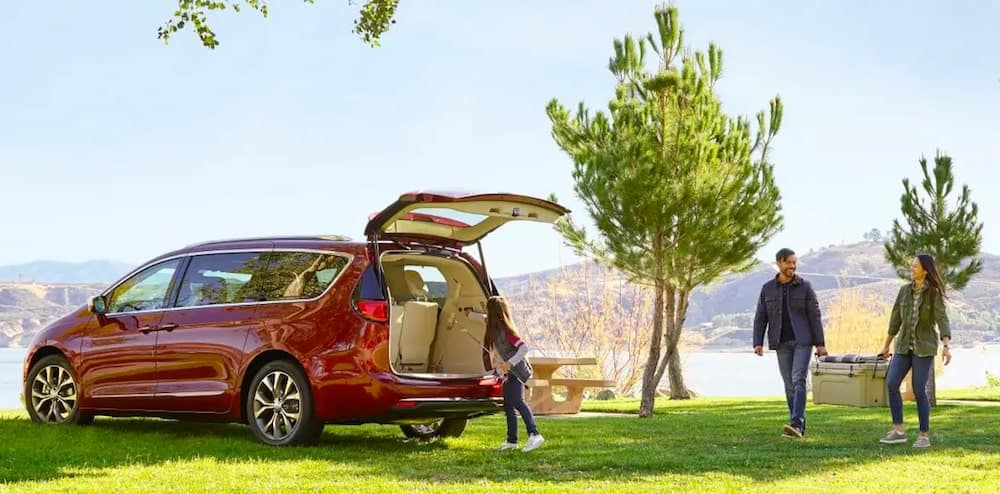 2019 Chrysler Pacifica with Family Storing Cargo in Trunk