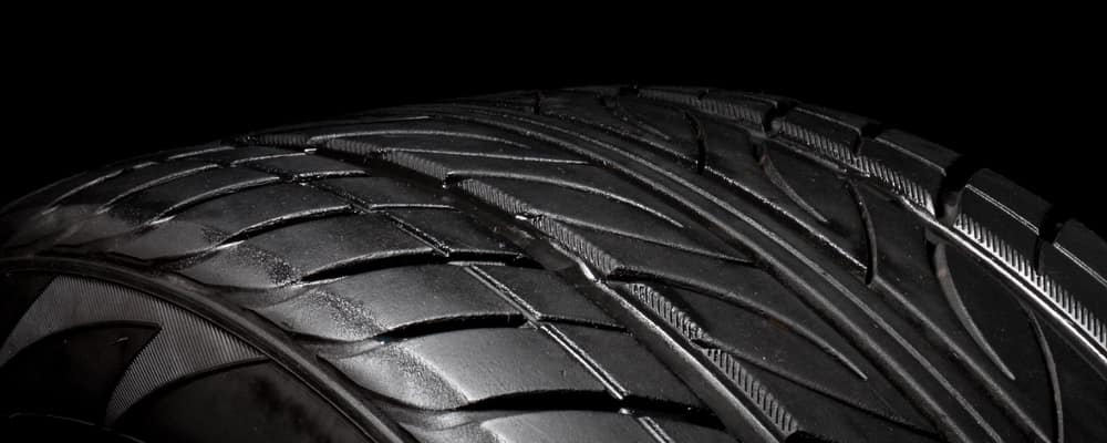 Close up car tire photo on the black background