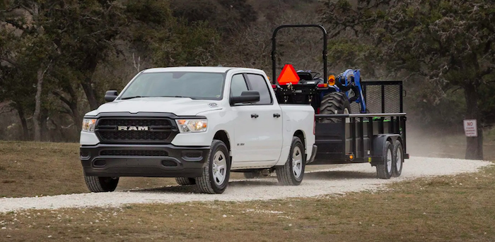 White Ram 1500 towing equipment on gravel road