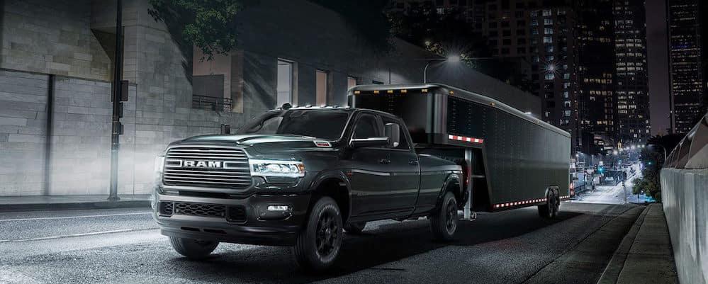 2019 Ram 2500 towing trailer at nighttime