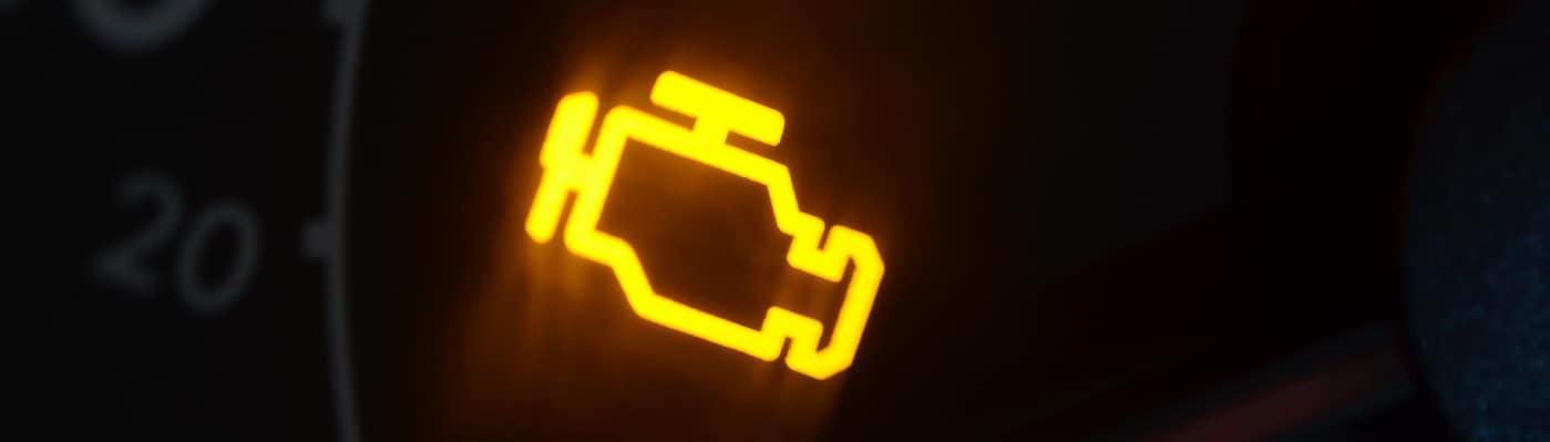 Illuminated check engine light on dashboard