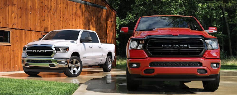 2020 RAM 1500 models parked outside of a barn